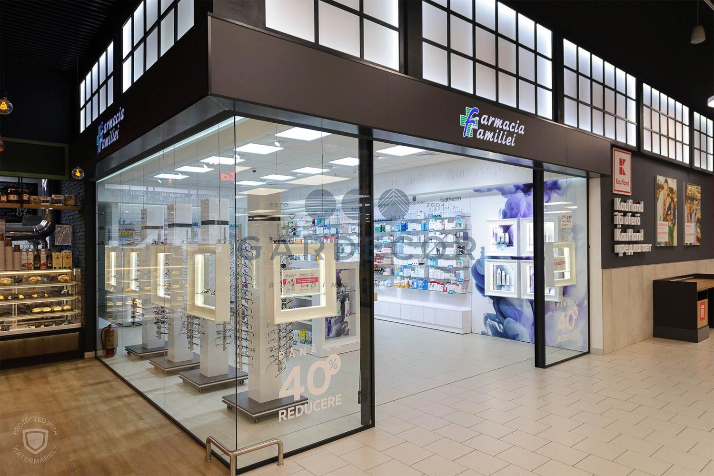 Delimitări magazine, farmacii  din centre  comerciale cu sticlă  personalizată